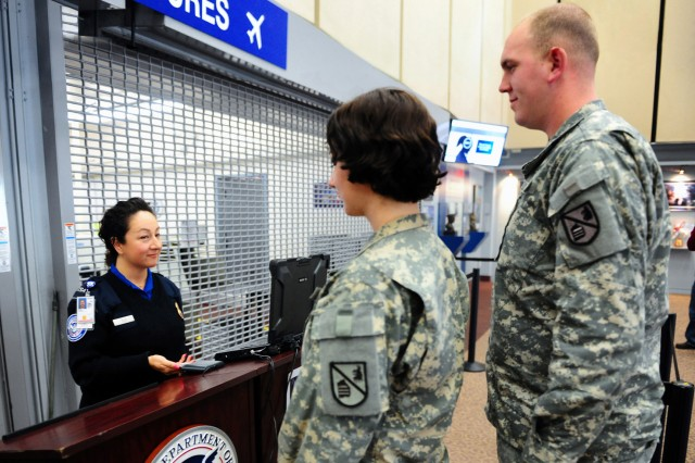 transportation security administration officer desiree kalin demonstrates to spc victoria grudzinski and spc michael