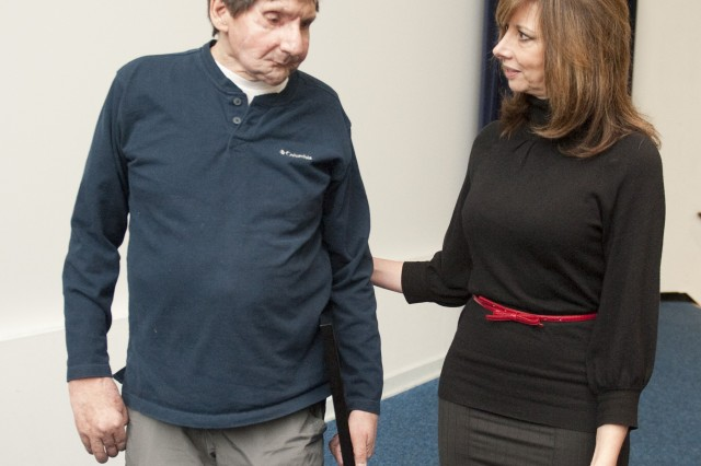 Face transplant recipient Jim Maki and Cheryl DeLuca, chief of the Natick Contracting Division, speak after a presentation at Natick Soldier Systems Center.