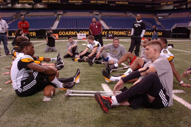 Wounded Warriors and Soldiers take a break during the Punt, Pass and Kick event at the San Antonio Alamodome, Jan. 4, 2012.