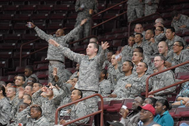 Soldiers react after discovering that they are shown on the video scoreboard during a University of South Carolina women's basketball game shortly before Christmas. Fort Jackson partnered with sports teams, local attractions, restaurants and other organizations to provide activities for the nearly 250 Soldiers who stayed on post during Victory Block Leave.
