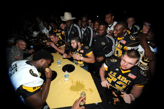 High school football players from East and West have a food-eating relay race at the Player-Hero Challenge on Wednesday night at Sunset Station in San Antonio. The Soldier-player bonding event was one of several pre-game festivities for the 2012 U.S. Army All-American Bowl to kickoff at noon Central Time Saturday at the Alamodome.