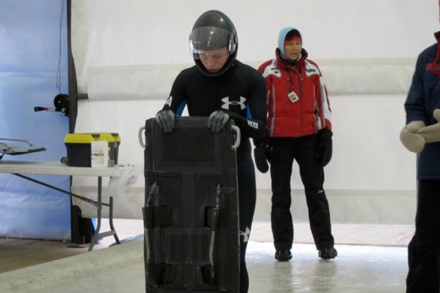 Spc. Megan Henry HHC 854th Engineer Battalion, prior to the start of a race in the Skeleton event during the America's Cup in Calgary, Canada.