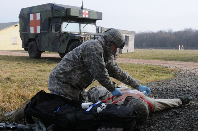 Soldiers of the 557th Medical Company (Area Support) provide first aid to simulated casualties during a field training exercise at the Mainz-Layenhof Training Area, February 17. (US Army Photo by Sgt. 1st Class Christopher Fincham)