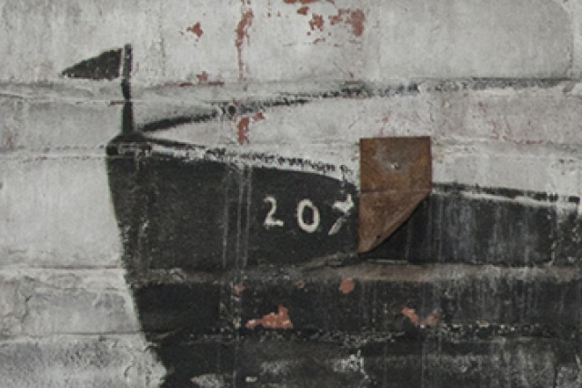 A close view of the bow of one of the ships depicted in the murals.