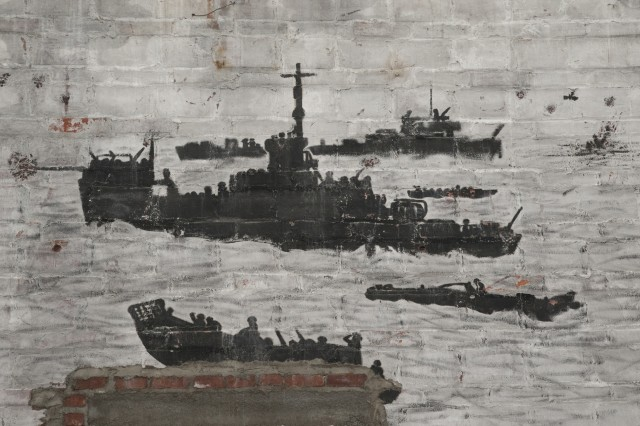 Images of ships afloat depicted in murals were uncovered during the renovation of a building at Picatinny Arsnenal, N.J.
