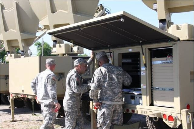 Soldiers of the 2nd Brigade, 1st Armored Division, test equipment during a Network Integration Evaluation at White Sands Missile Range, N.M.