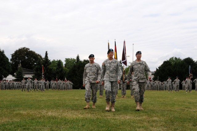 Brig. Gen. Nadja Y. West, the commander of the Europe Regional Medical Command, leads Col. Daniel P. Orrico, the 30th MEDCOM chief of staff, and Col. John M. Cho, the 30th MEDCOM commander, to the reviewing stand following the passing of the colors. (US Army photo by Sgt. 1st Class Christopher Fincham)
