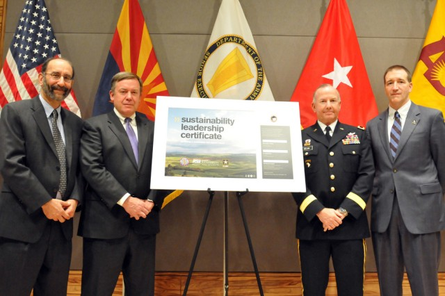 Dr. Rob Melnick, the executive dean of Arizona State University's Global Institute of Sustainability (left), Michael Crow, the president of Arizona State University (left center), Army Brig. Gen. Daniel Nelan, the operational support assistant to the director of the Army National Guard (right center) and Richard G. Kidd IV (center), the deputy assistant secretary of the Army for energy and sustainability pose with the sustainability leadership certificate that was signed to commemorate a new sustainability education initiative between the ARNG and ASU, Jan. 6, 2011, at the Army National Guard readiness center in Arlington, Va.