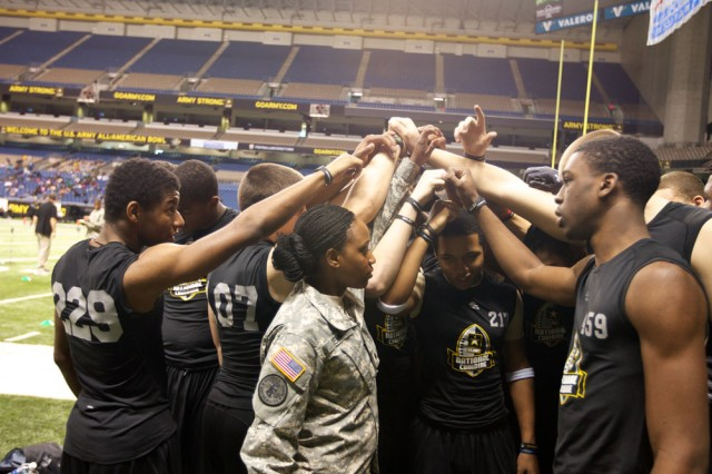 "Phylesha Kemp, a junior ROTC Cadet from Georgia State University, leads her group of National Combine participants in sounding off with their team motto: ""One team. One dream."""