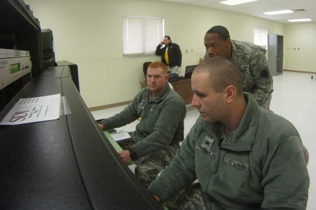 Two Gray Eagle operators from F Company, Combat Aviation Brigade, 1st Infantry Division, perform training operations at Fort Riley, Kan., with support from personnel from the Directorate of Training and Doctrine. These Soldiers will become Master Gunners and will train other members of F Co. on Gray Eagle operations.
