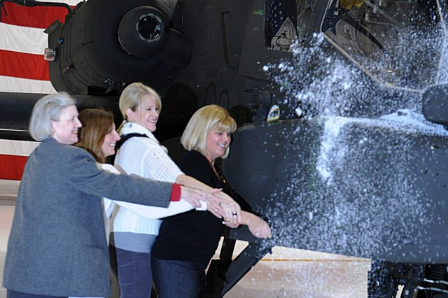 The spouses of current and former 1-135th Attack Reconnaissance commanders christen the first Apache Longbow; from left, Barbara McNeal, Deanna Burson, Julie Hausman and Julie Schreffler.