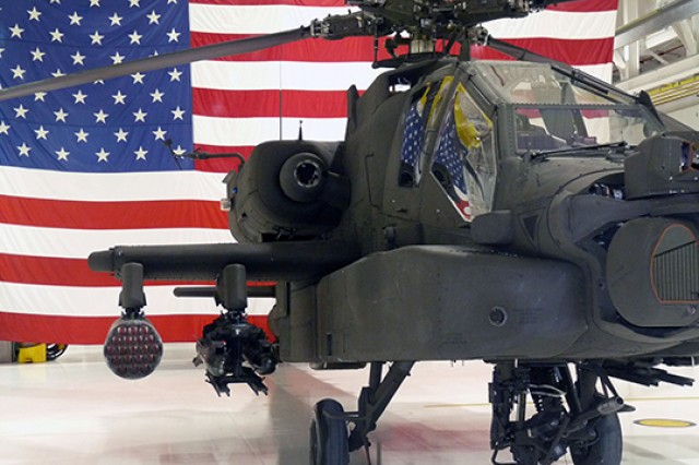 A new AH-64 Apache Longbow graces the hangar of the 35th Combat Aviation Brigade at Whitman Air Force Base, Mo.