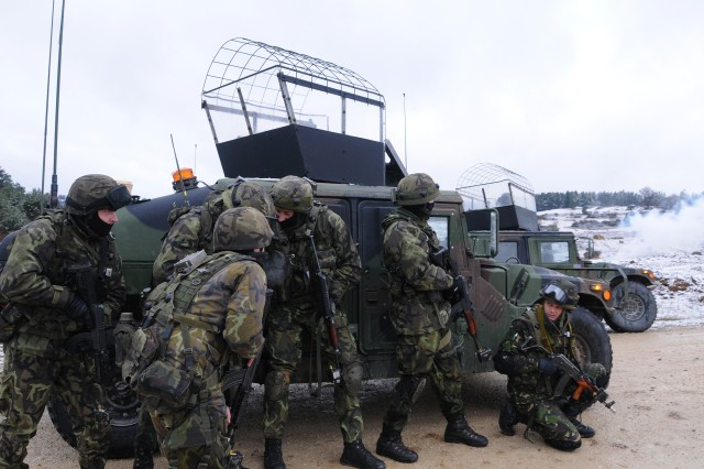 Czech Republic soldiers from an operational mentor and liaison team pull security before reacting to a previous hasty attack training exercise at the Joint Multinational Readiness Center in Hohenfels, Germany, Nov. 17, 2011. The soldiers trained in preparation for their deployment to Afghanistan.