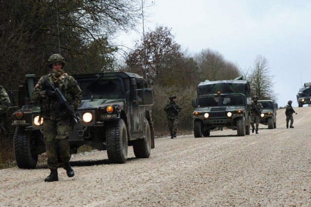 German and Czech soldiers from an operational mentor and liaison team conduct a dismounted tactical road march during a previous training exercise at the Joint Multinational Readiness Center in Hohenfels, Germany, Dec. 6, 2011.