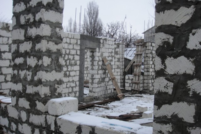 Walls go up on the new administration section of the Edinet Fire and Rescue Station, as construction and renovations continue Dec. 22, 2011, in Moldova. The project, being overseen by the U.S. Army Corp of Engineers Europe District, is funded by U.S. European Command's humanitarian assistance program.