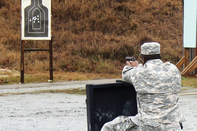 A Soldier fires his weapon during the 209th Military Police Detachment's Firearms Qualification Course at the Russell County Sheriff's Range. The Pentagon announced Friday that the Fort Benning detachment won the Brig. Gen. Jeremiah P. Holland Award as the Army's top military police unit for fiscal 2011.