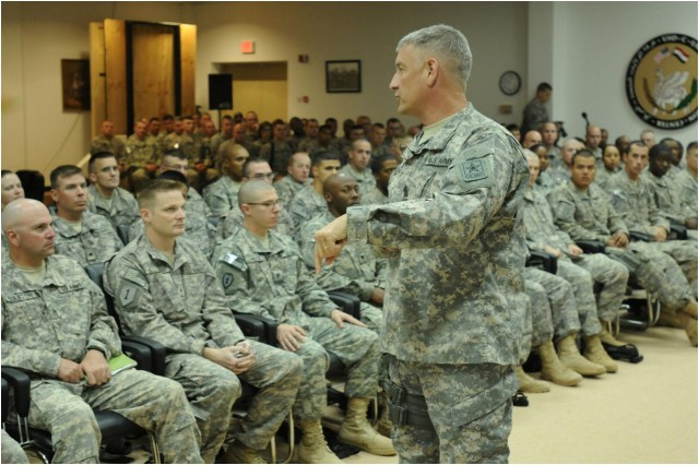 """Soldiers from United States Division-Center listen as Sgt. Maj. of the Army Raymond F. Chandler III discusses the Army's future during his visit to Camp Liberty, lraq, June 24, 2011. Chandler discussed topics as varied as the new Physical Readiness Test and the changes in the """"don't ask, don't tell"""" policy."""
