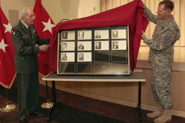 Retired Gen. Donn A. Starry and Lt. Gen. Robert P. Lennox, the Army G-8, unveil the Force Management Hall of Fame display during Starry's induction ceremony June 15, 2011, at the Pentagon. Starry is only the 10th inductee into the hall of fame. The display hangs on the wall in the E-Ring of the Pentagon in the G-8 area.