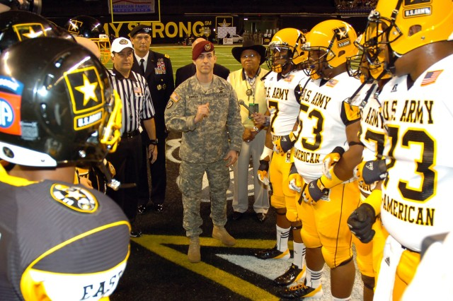 Sgt. 1st Class Steve Kimsey of the 95th Civil Affairs Brigade (Airborne), performs the coin toss before the start of the 12th annual U.S. Army All-American Bowl in San Antonio, Jan. 7, 2012.