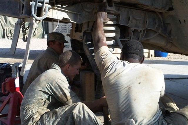 Soldiers of Trp. B, 1-3 Cav. Regt., repair the axle of a humvee on Contingency Operating Site Kalsu, Nov. 2010. Maintenance Soldiers worked long hours to contend with the taxing operational tempo during Operation New Dawn. (U.S. Army photo by Spc. Adam Hefner, 3rd Cav. Regt. Public Affairs)