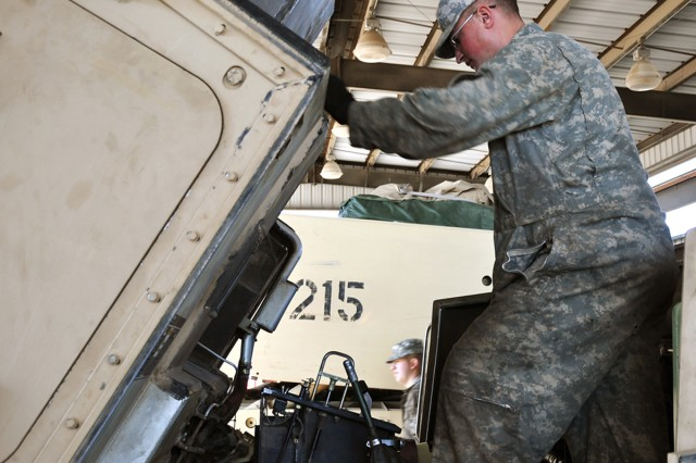 Private 1st Class John Horton, a track mechanic with the combat repair team for Btry. B, 2-20 FA Regt., 41st Fires Bde., checks his work during a maintenance inspection he conducted on an M-270 Multiple Launch Rocket System in the unit's motor pool Jan. 6. The battery earned top honors in the AAME, small unit category, at the U.S. Army Forces Command level of the competition. (U.S. Army photo by Staff Sgt. Kyle Richardson, 41st Fires Bde. Public Affairs)