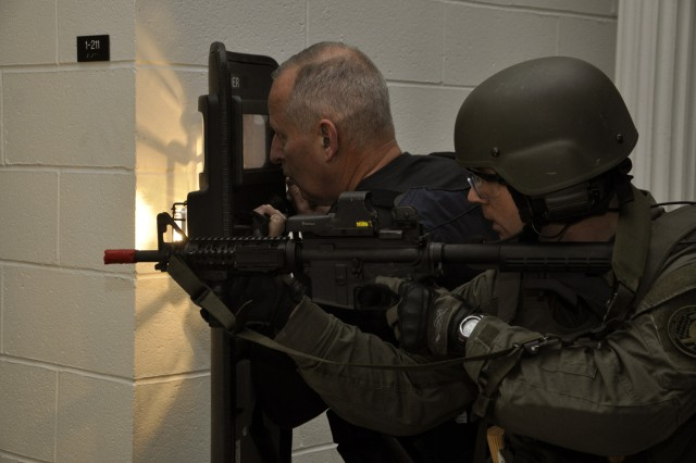 FBI SWAT team member, right, conducts one-on-one training with Sgt. Bill Pryor, from the Watervliet Arsenal, N.Y., Security Office.