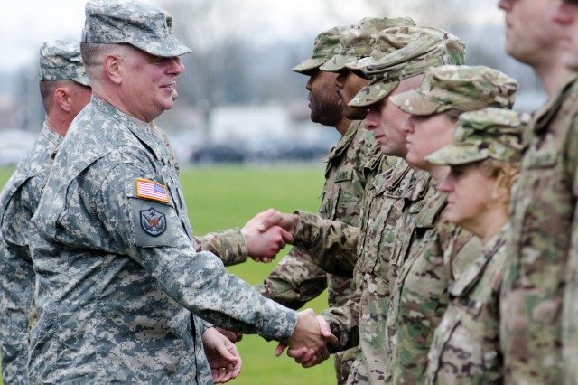 Brig. Gen. Mark Inch, left, U.S. Army Military Police School commandant, meets with HHC, 42nd MP Bde. Soldiers at JBLM's Watkins Field, Jan. 4. Inch attended a colors casing ceremony, which will soon be followed by the deployment of HHC troops in support of Overseas Contingency Operations.