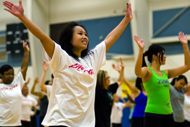 Aerobathon participants get Zumbafied at Wilson Sports and Fitness Center, Jan. 7. The sixth annual FMWR event consisted of fitness classes and an extended indoor cycling session.