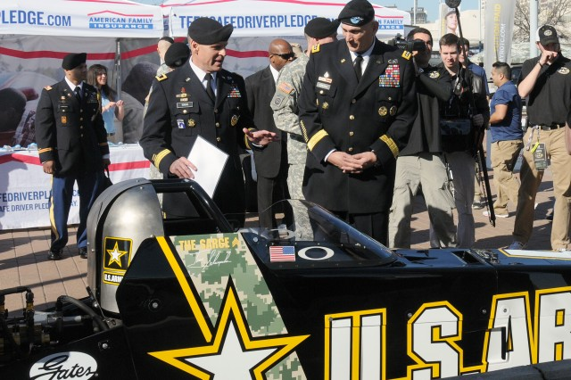 Army Chief of Staff Gen. Raymond T. Odierno visits the Army race car at the Army Strong Zone located outside the Alamodome in San Antonio, before the All-American Army Bowl began the following day with Maj. Gen. David L. Mann, commanding general of U.S. Army Recruiting Command.
