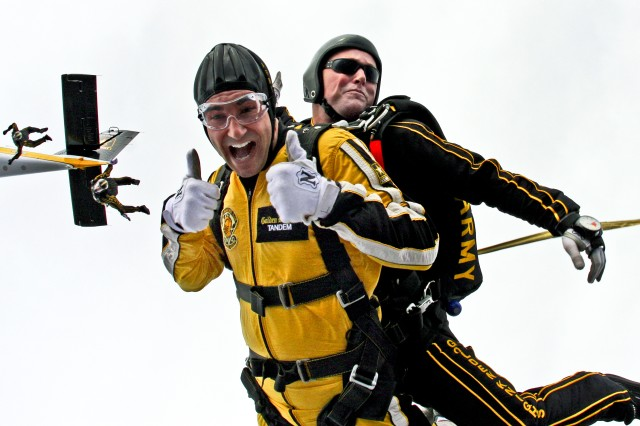 Staff Sgt. Joe Jones from the U.S. Army Parachute Team, pitches the drogue as he takes Medal of Honor recipient Staff Sgt. Salvatore Giunta for a 14,000-foot tandem skydive over Stinson Airfield, San Antonio. Sgt. Maj. Stephen Young and Lt. Col. Joe Martin are seen diving out behind. For more photos like this check out the 2011 Army Year in Photos at http://www.army.mil/yearinphotos/2011/.