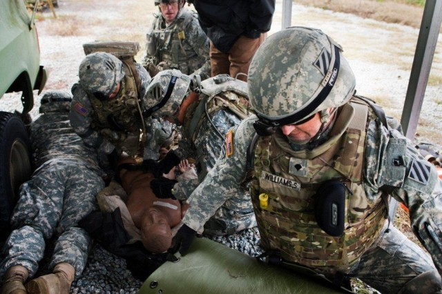 Specialist Shawn Williams, HHC, 1/64 Armor, 2HBCT, 3rd Inf. Div., along with other Soldiers prepare to move a casualty to safety during the Spartan Brigade's Basic Combat Team Trauma Training exercise at Evans Army Air Field, Dec. 9.