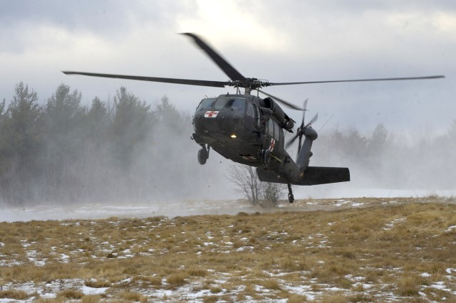 Maj. Michael McFadden, pilot and commander of C Company, 3rd General Support Aviation Battalion, 10th Combat Aviation Brigade, lands a UH-60 Black Hawk helicopter Jan. 9 during a medical evacuation training exercise on Fort Drum.