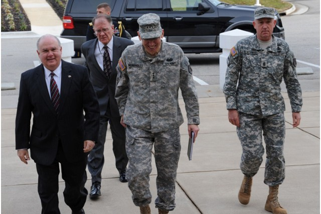 Lt. Gen. Rhett Hernandez, the commander of U.S. Army Cyber Command and 2nd Army, and Command Sgt. Maj. Roger P. Blackwood, the senior-enlisted advisor for U.S. Army Cyber Command and 2nd Army, escort Under Secretary of the Army Dr. Joseph W. Westphal and Deputy Chief Management Officer, U.S. Army, Mark Lewis into the U.S. Army Cyber Command Headquarters at Fort Belvoir, Va., Jan 10. Westphal visited U.S. Army Cyber Command to gain situational awareness and ensure the Army is correctly prioritizing, balancing and integrating resources to support the mission of this newly-established, and mission-critical organization.