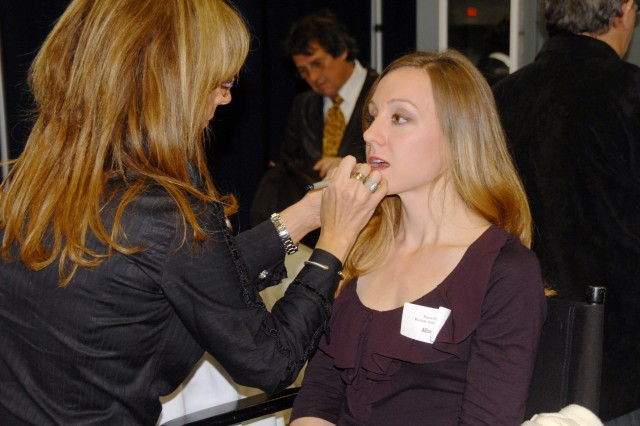 Allison Stout, Army wife of six years, sits for a makeover at the Military Spouse Career Forum in Washington, D.C., Jan. 13, 2012. Stout attended the forum, having just recently moved to the area, to gain some insight into the local job market and get tips on how to propel her career forward despite the challenges she faces as a military spouse.