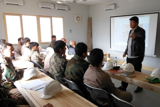 An Afghan instructor lectures new operations and maintenance students during the first week of training at the Afghan Air Force's 205th Atal Corps Air Wing on Kandahar Airfield, Afghanistan.