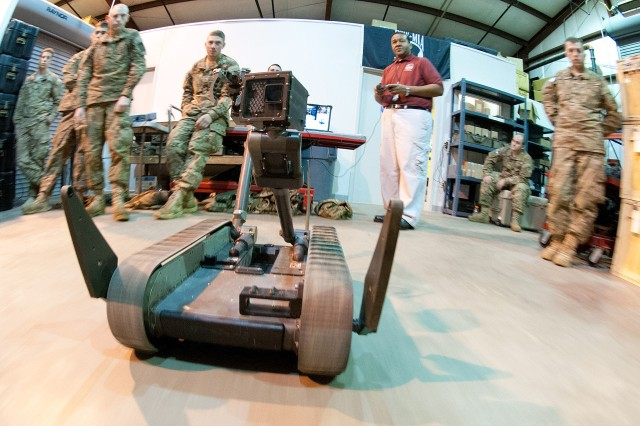 Don Thompson, a civilian trainer for a battlefield robot, demonstrates how to operate the system to paratroopers with the 82nd Airborne Division's 1st Brigade Combat Team, Jan. 9, 2012, at the Joint Readiness Training Center, Fort Polk, La.  The robot's top speed is faster than a person can walk.