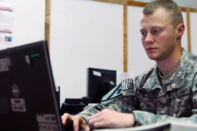 CAMP BUEHRING, Kuwait -- Apple Valley, Ca. native, Spc. Matthew McPherson, a military intelligence (all source) analyst, assigned to the A Co., 1st Brigade Special Troops Battalion, 1st Brigade Combat Team, 1st Cavalry Division, works at a computer terminal, here, Jan 9. McPherson was selected among five peers who competed in the Ironhorse Brigade for the Command Sgt. Maj.(Ret.) Doug Russel Award, an award given to those with outstanding achievements within the Military Intelligence community. He will now compete against fellow Soldiers at the Department of the Army level.