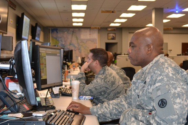 U.S. Army Maj. William Toles (on the right) and U.S. Air Force Maj. Chad Annunziata monitor global surface movements and port operations.  Toles is a transportation officer assigned to the Command Operations Center Battle Staff, and Annunziata is an operations officer assigned to the COC Battle Staff. (U.S. Army photo by Mark Diamond, Hq. SDDC Public Affairs)