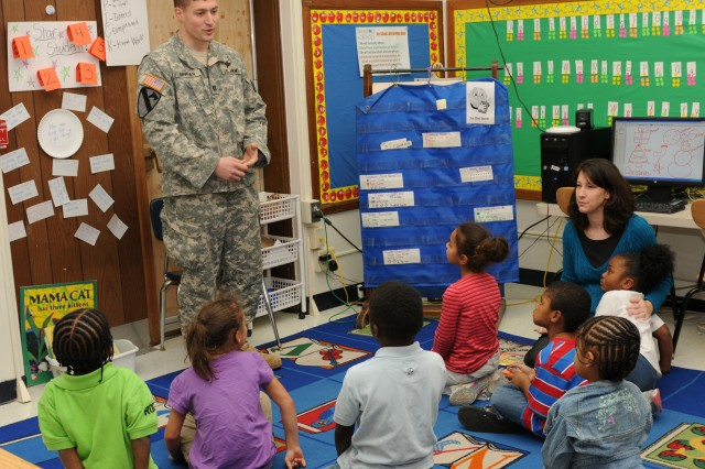 Capt. Justin Bergen, ASC's Headquarters and Headquarters Company commander, speaks to students Dec. 20 at Lincoln Academy, Davenport, Iowa. Bergen is just one of ASC's volunteers in Partners in Education, a program focused on mentoring students