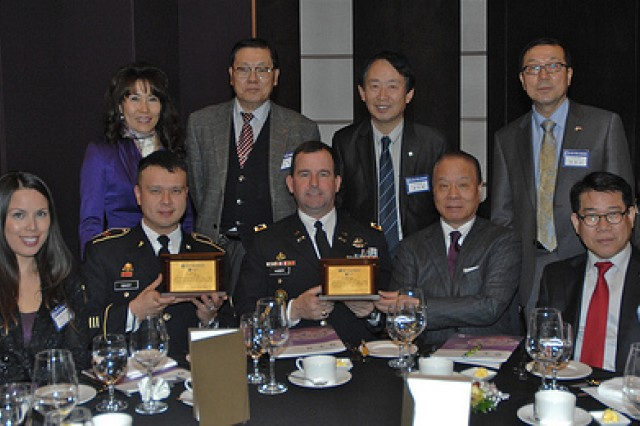 First Sgt. Ronald Nagy, left, and Col. William Huber sit with the rest of the New Seoul Chapter of People to People International during the PTPI 39th Award Dinner and Banquet Jan. 13. They were awarded for their efforts in building the bost between Yongsan Garrison and the off-post community.