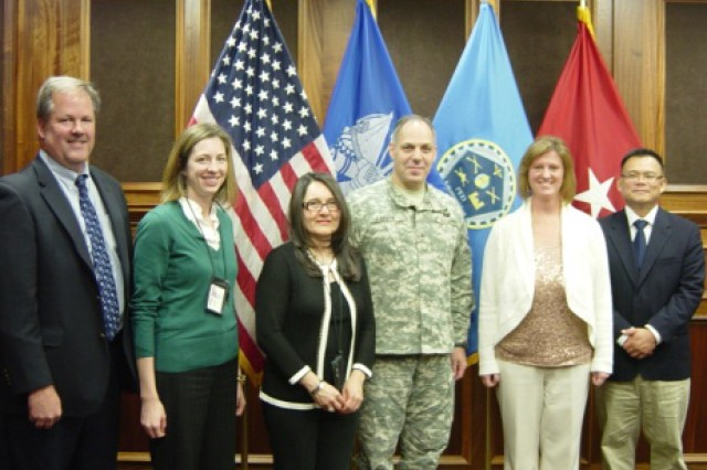 Brig. Gen. (P) Gustave A. Perna presented commander's coins to the Picatinny Arsenal Value Engineering Team. From left, Glenn Knudsen, Kristin McGroarty, Marisel Lipinski, Perna, Barbara Gabbard and Ferdinand del Carmen (ARDEC). Courtesy photo.
