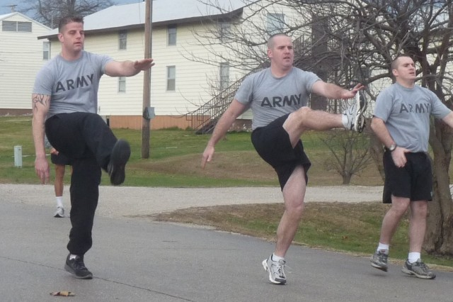 Missouri Army National Guard 1st Lt. Adam Von Allmen, center, leads  Soldiers in a high-kick drill as part of the 140th Regiment Missouri Regional Training Institute's Unit Fitness Coordinator Course at Fort Leonard Wood, Mo.