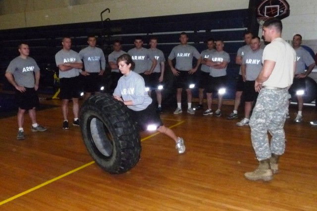 Spc. Alexiss Petree flips a tire as part of the 140th Regiment Missouri Regional Training Institute's Unit Fitness Coordinator Course at Fort Leonard Wood, Mo.