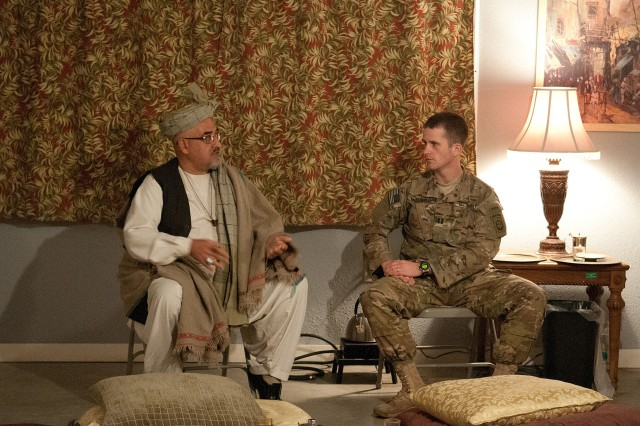Capt. Tim McDonald, a cavalry troop commander with the 82nd Airborne Division's 1st Brigade Combat Team, discusses his performance at a key leader engagement with Afghan cultural advisor, Haji Bashid, Jan. 15, 2012, at the Joint Readiness Training Center, Fort Polk, La.  The KLE took place at JRTC's Engagement University, a facility that teaches commanders how to build relationships with Afghan leaders.  (U.S. Army photo by Sgt. Michael J. MacLeod)
