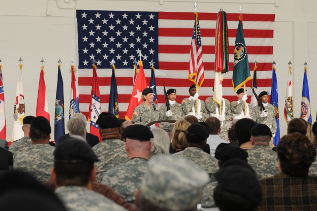 Maj. Gen. Patricia McQuistion, Army Sustainment Command's commanding general, speaks to audience members during the Jan. 18 Change of Responsibility ceremony held in honor of Command Sergeants Major Stephen Blake and James Spencer.