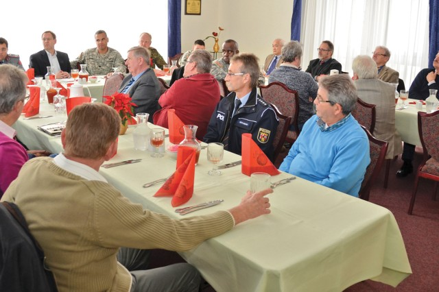 Mayors and officials from communities in the local area meet with Lt. Col. Sam McAdoo, U.S. Army Garrison Baumholder commander, at the Rheinlander Community Club to discuss the future of the Baumhold military community.