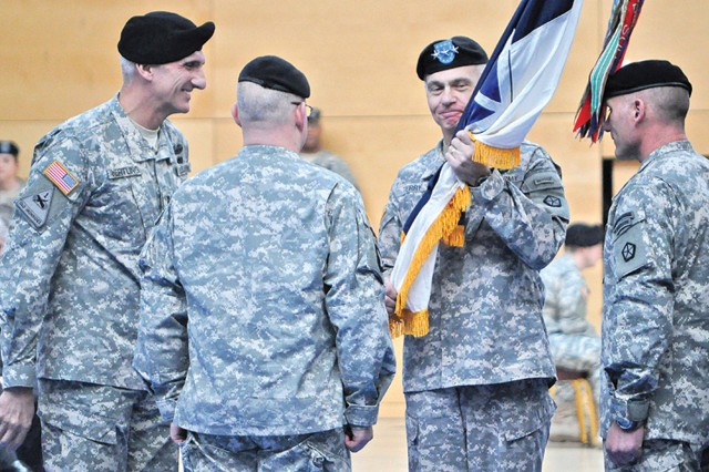Lt. Gen. Mark Hertling (from left), U.S. Army Europe commander, and Brig. Gen. Ricky Gibbs, deputy V Corps commander, look on as Lt. Gen. James Terry assumes command of V Corps in Wiesbaden, Germany, Jan. 10, 2012.