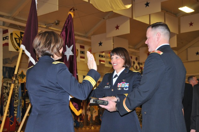 FORT CARSON, Colo. -- Lt. Gen. Patricia Horoho, Army surgeon general, administers the general officer's oath to Maj. Gen. Jimmie O. Keenan Jan. 12 while her husband, Deputy Garrison Commander Col. John Keenan, looks on.