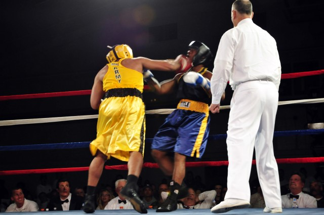 Sgt. Charles Blackwell, an Army Reserve Soldier from Arizona, lands a right hook on the chin of Seaman Tyron Hunter of Naval Air Station Lemoore, Calif., in the 201-pound finale of the 2010 Armed Forces Boxing Championships April 23 at Naval Base.