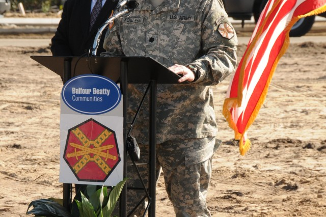 Hunter Army Airfield Garrison Commander Lt. Col. Edward Kovaleski speaks at the Hunter Ridge groundbreaking ceremony as Joel Jacobs, Deputy Project Director for BBC at Stewart-Hunter, stands behind, Jan. 12.